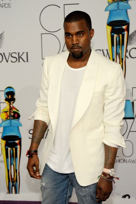 Kanye West's Style | 2011 - Kanye working the white suit with a 'I'm not trying too hard' look going on