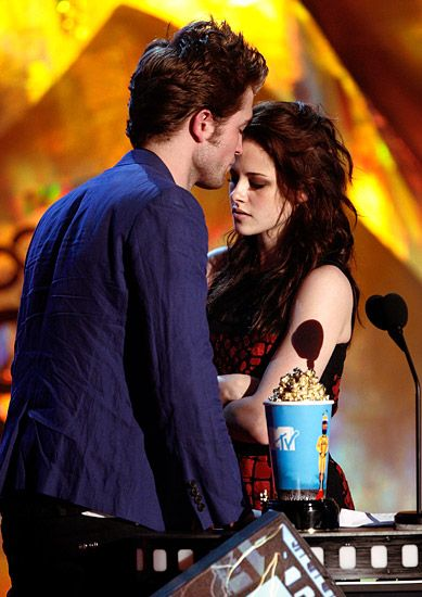 2013 MTV Movie Awards | Best Lip Locking Celebs - After winning Best Kiss Robert Pattinson decided to get up close and personal with co-star Kristen Stewart. Close your eyes this won't hurt a