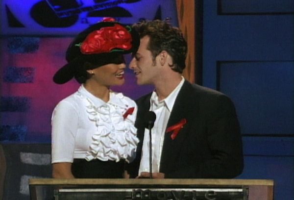 2013 MTV Movie Awards | Best Lip Locking Celebs - Tia Carrere and Luke Perry presented at the very first MTV Movie Awards in 1992 starting the kiss movement.