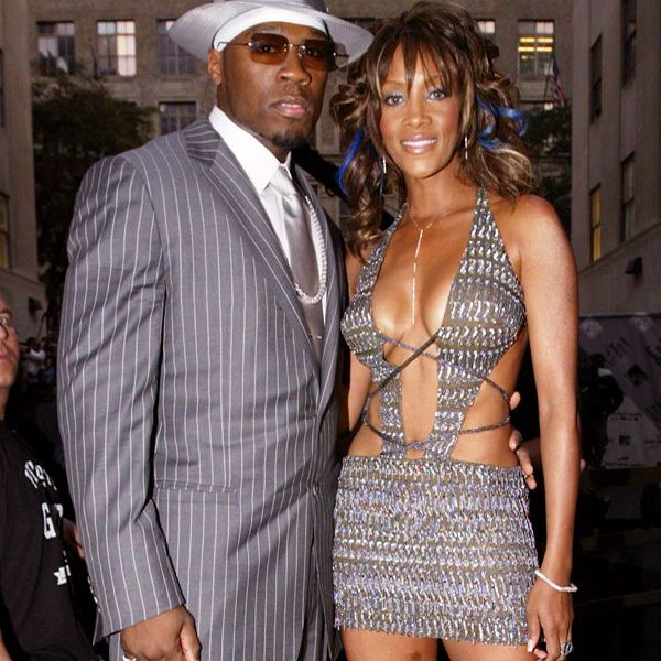 VMA Fashion | Barely There - 08.28.2003, New York City, NY: Vivica A. Fox keeps 50 Cent's attention at the 2003 MTV VMAs.