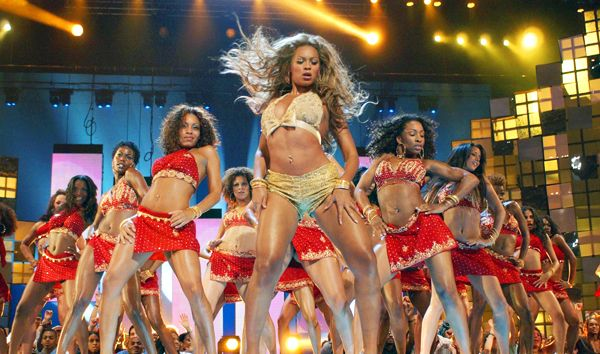 VMA Fashion | Barely There - 08.28.2003, New York City, NY: This luscious lady has the right moves...and outfit! Bootylicous Beyoncé grooves at the 2003 MTV VMAs.