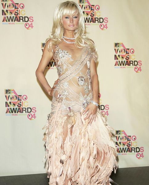 VMA Fashion | Barely There - 08.29.2004, Miami, FL: Just when you thought you'd seen enough of Paris Hilton, she appears at the 2004 VMAs barely covered in sequins and feathers.