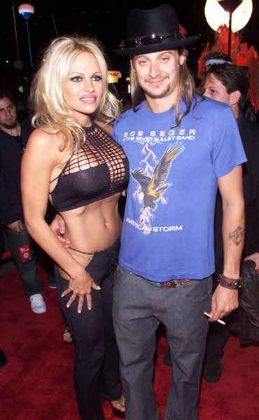 VMA Fashion | Barely There - 09.06.2001, New York City, NY: Pamela Anderson stole the spotlight in this busty number when she and then boyfriend Kid Rock stepped out on the carpet at the 2001 VMAs.