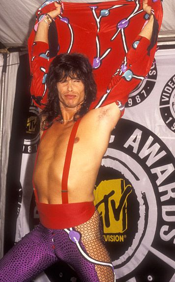 VMA Fashion | Barely There - 9.11.1987, Los Angeles, CA: No need for a shirt, Steven Tyler, especially when you have killer mesh purple leggings.
