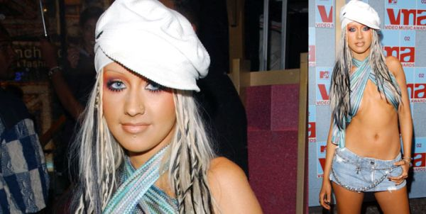 VMA Fashion | Barely There - 08.29.2002, New York City, NY: Christina Aguilera is fully dressed in a scarf and a smirk at the 2002 VMAs.