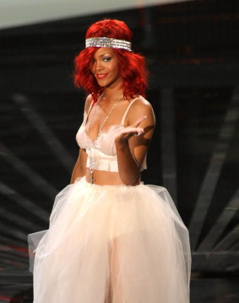 2012 VMA | Rihanna VMA Fashion Over the Years - Rihanna performing live on stage with Eminem at the 2010 VMAs