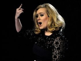 2012 Brit Award Winners - Adele Wins Big and Flips Middle Finger