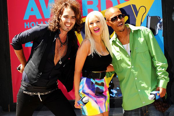 Best Moments for Movie Award Host - Russell Brand - Russell Brand joins Christina Aguilera and T.I. at the 2008 MTV Video Music Awards press conference