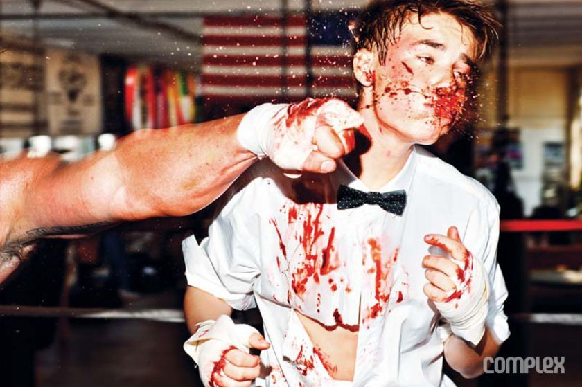 Justin Bieber Bloody But Not Beaten - Ouuuch - Splash - ugggh. Photography by Tony Kelly for Complex Magazine. ADDITIONAL CREDITS: (STYLING) Matthew Henson. (GROOMING) Vanessa Price. (MAKEUP) Miho Suzuki. (CLOTHING) Suit by Dolce & Gabbana / Shirt by Won Hundred / Bow tie by TOPMAN / Shoes by Android Homme.