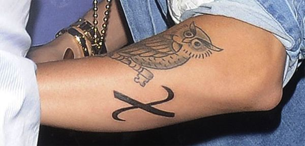 Justin Bieber's Tattoo Collection - Justin Bieber Tattoo #12 - Greek Symbol for Chi on left arm