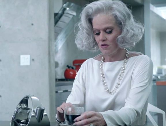 Old Lady Katy VS Young Katy - Katy in her old lady look with big grey hair, glamorous pearls and white mature top yet she still looks very sad and vunerable