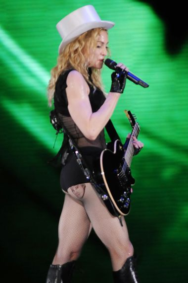 Celebrities With Justin Bieber Tattoos - Madonna! We had no clue! No wonder why she's in the gym 24 hours a day -- she has to keep that Justin Bieber tat... taught.