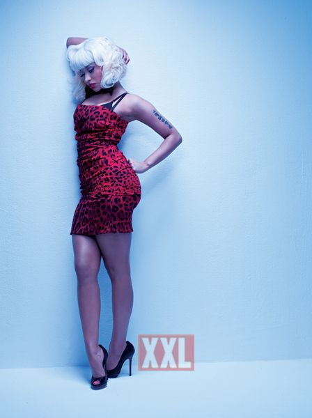 Nicki Minaj Booty Pictures - Nicki Minaj in a Marilyn Monroe look-a-like with red leopard print, brack glossy super hi's and not much else