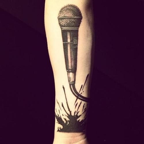 One Direction | Boy Cru Tattoos - Zayn also has this huge microphone on his right arm! His buddies in One Direction have been seen poking fun at it.