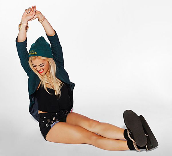 Rita Ora's Exclusive MTV Photo Shoot - Rita wears a hat by The Hundreds; jacket by Moschino; top by Pavonine; shorts by Joy Rich; creepers by Bess NYC; bangle by Laruicci; ring by Materia Prima; necklace and watch are Rita's own.