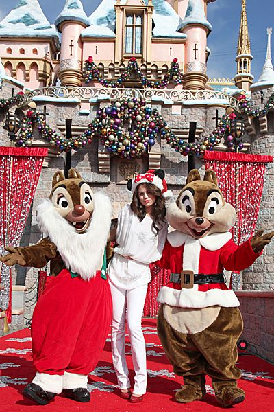Evolution Of Selena Gomez - Selena Gomez meets Chip and Dale during the Disney Parks Christmas Day Parade on November 7, 2010.