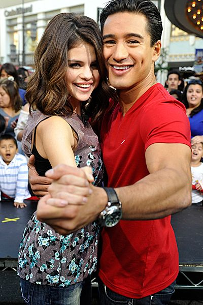 Evolution Of Selena Gomez - Selena Gomez hangs out with Mario Lopez on the set of 'Extra' at The Grove on November 9, 2010.