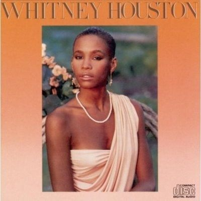 Whitney Houston | Timeline - 1963 to 2012 - Whitney Houston releases her debut album in 1985