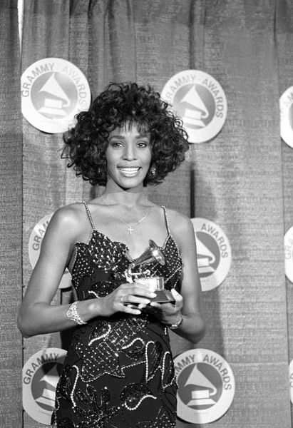 Whitney Houston | Timeline - 1963 to 2012 - Whitney poses with her Grammy after she was named Best Pop Vocal Performer - 1988