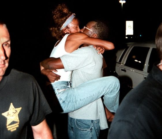 Whitney Houston | Timeline - 1963 to 2012 - Whitney Houston - 2000 greets Bobby Brown after he was released from jail after serving a 65 days of a 75-day sentence for repeatedly violating his parole on a 1996 drunk driving conviction.