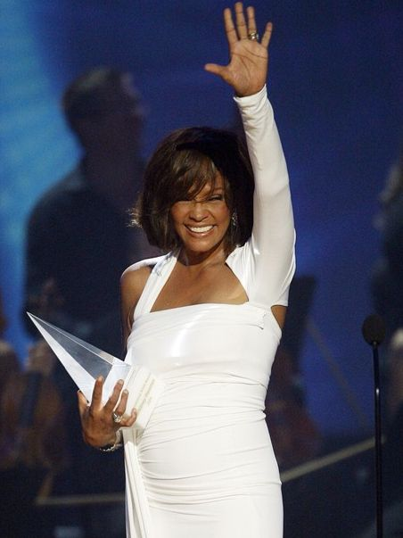 Whitney Houston | Timeline - 1963 to 2012 - Whitney Houston - 2009 - accepts the International Artist of the Year award at the 2009 American Music Awards.